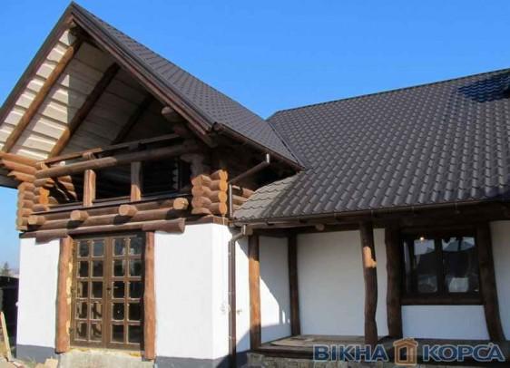 Вікна і двері виробництва ТМ КОРСА в дерев'яних будинках