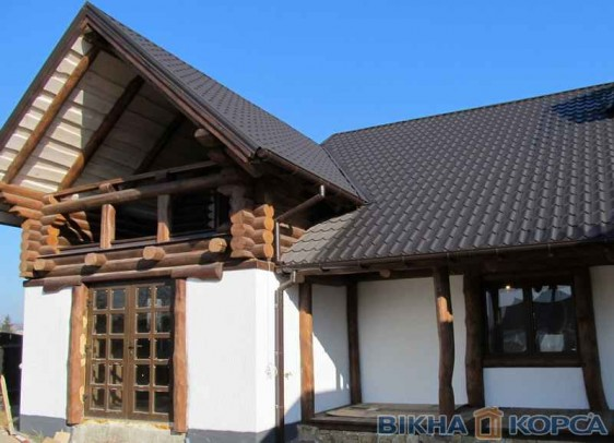 Окна и двери производства ТМ КОРСА в деревянных домах